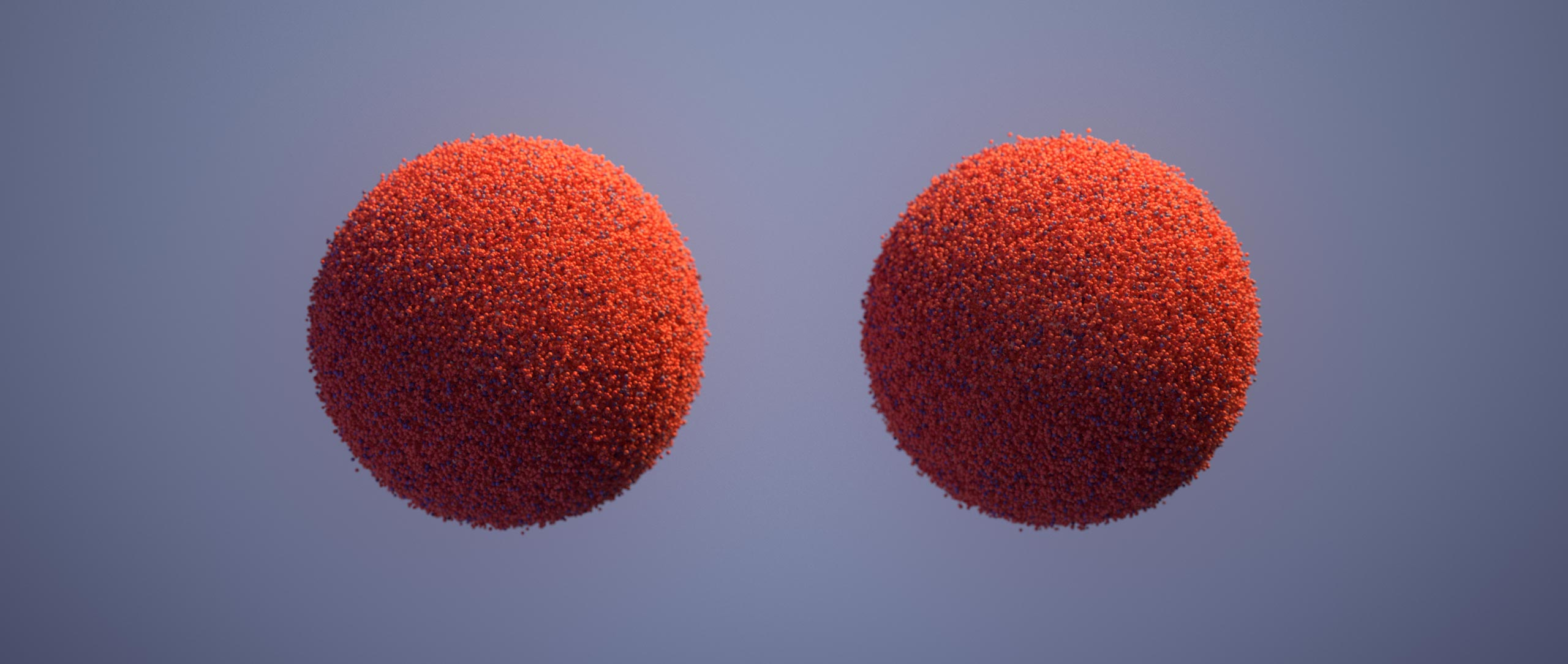 An orange ball decomposing into points and rematerializing as two balls, each the same size as the first.
