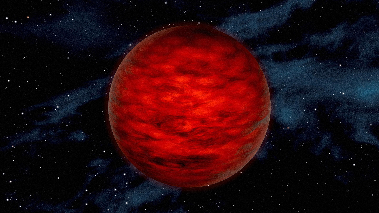 A dark red planetlike object.