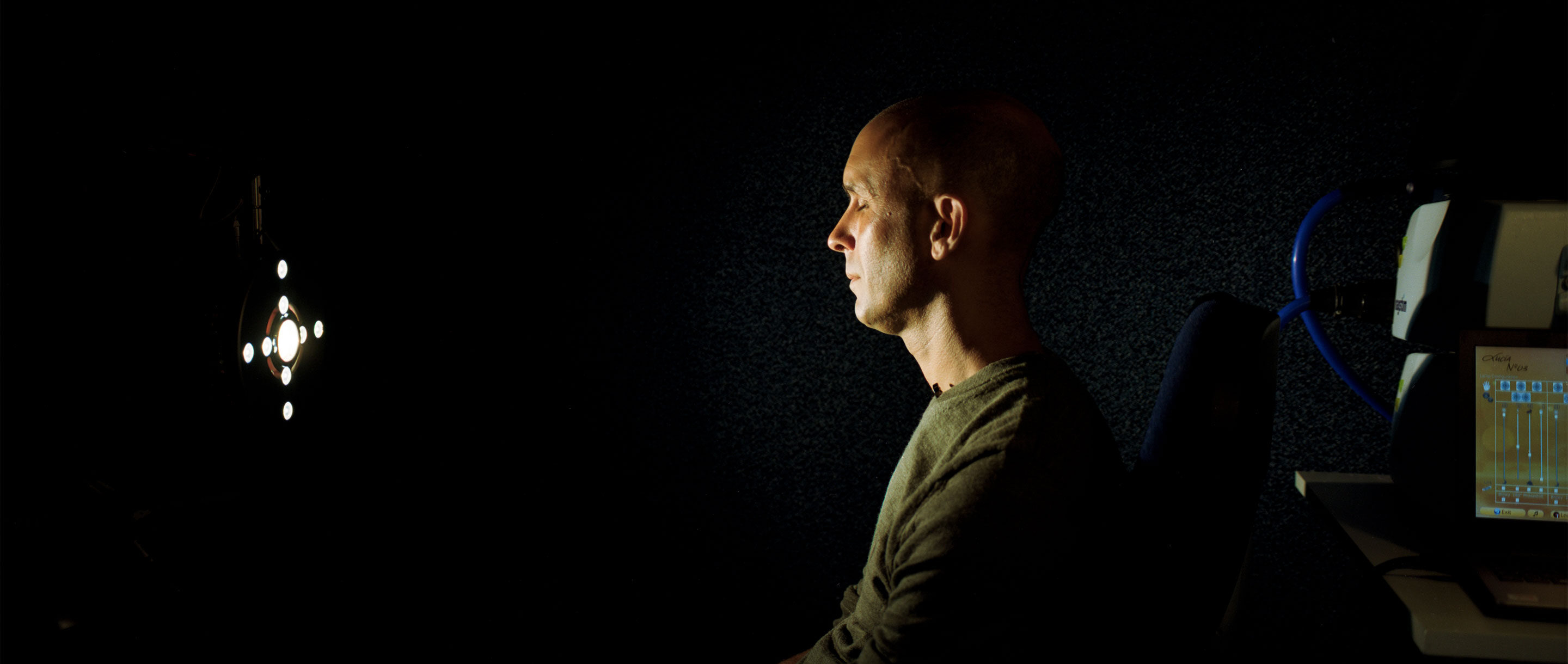 Neuroscientist Anil Seth in his darkened laboratory at the University of Sussex.