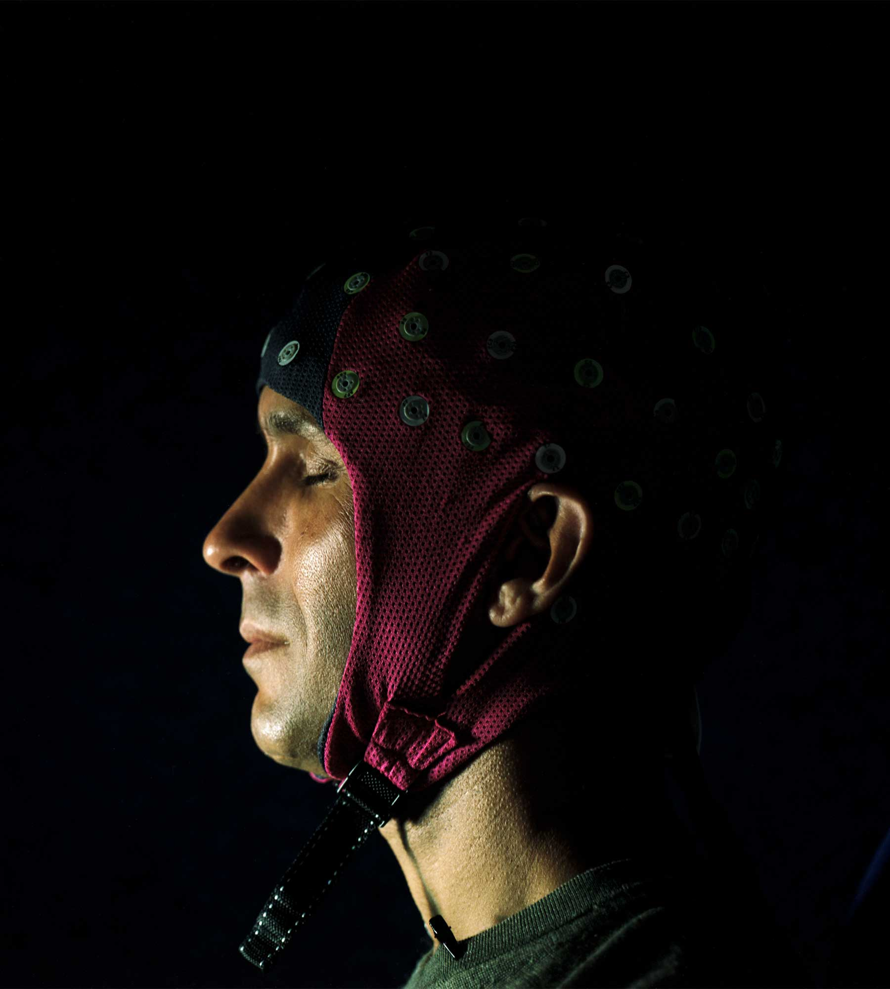 Seth wears a cap covered with sensors for monitoring the brain.