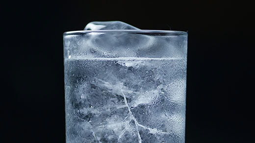 A GIF of ice melting in a glass of water