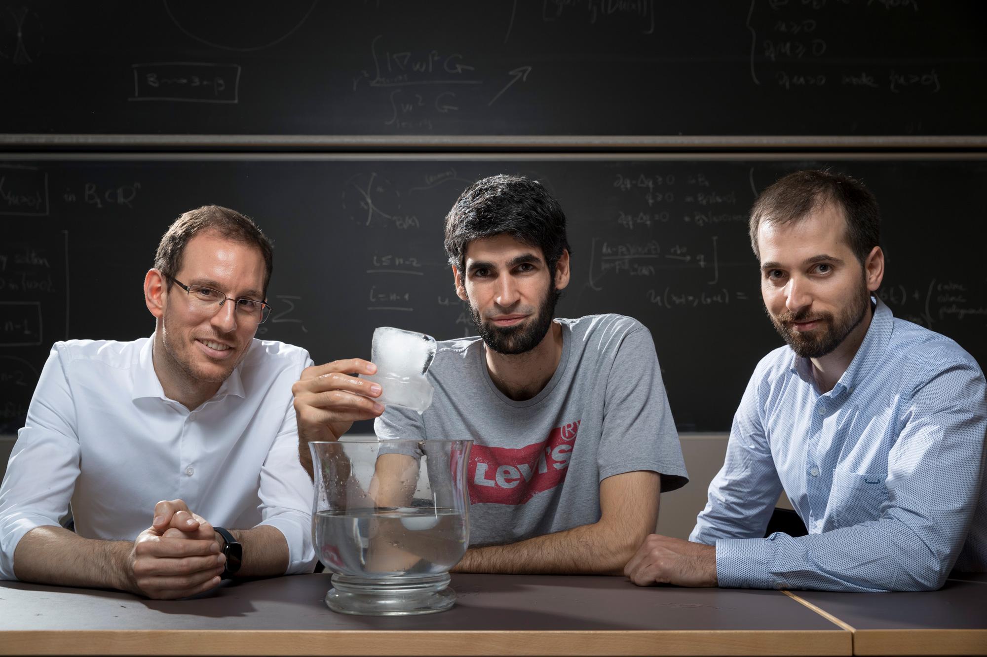 A photograph of mathematicians Alessio Figalli, Xavier Ros-Oton and Joaquim Serra.